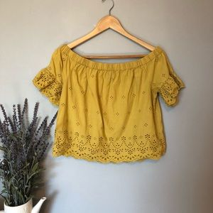 Yellow off the shoulder eyelet top.